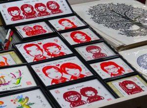 wycinanki karykatury singapur